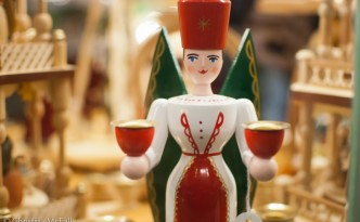 carved wooden angel candleholder at german christmas market