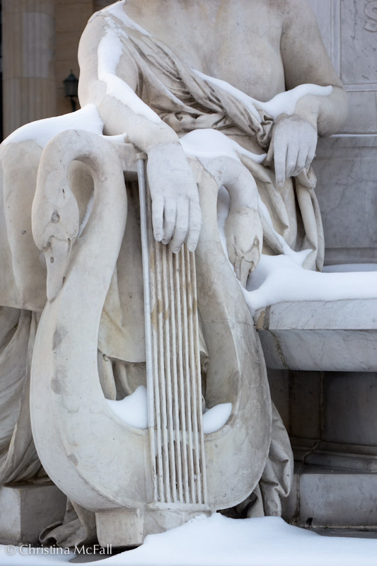 Poetry with her swan harp on the Schiller monument in Berlin