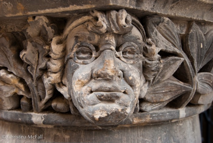 stone carving of face with glasses on rathaus in quedlinburg germany