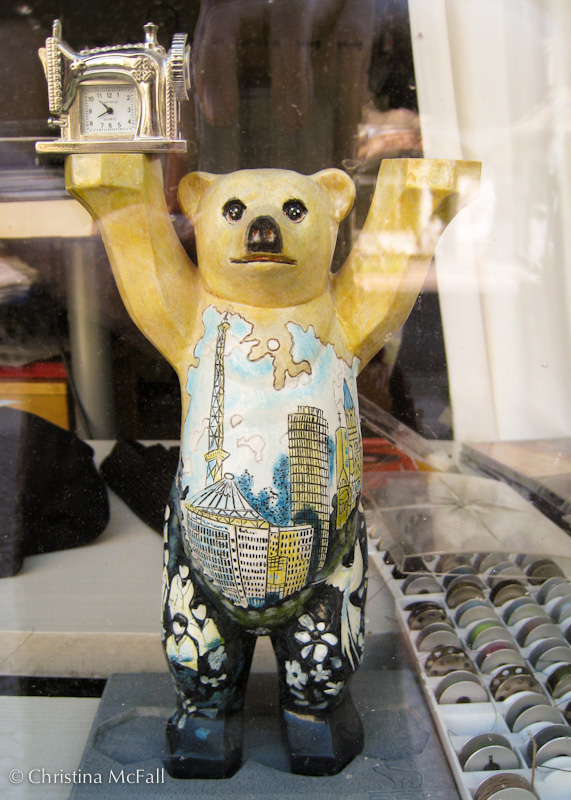 berlin buddy bear figurine with sewing machine clock